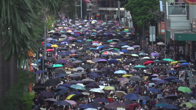 peaceful pro democracy march through hong kong - marching stock videos & royalty-free footage