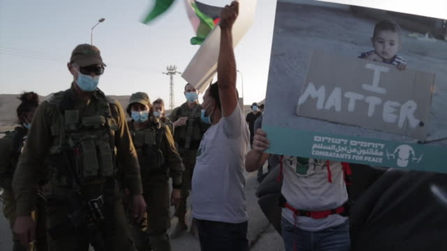 peaceful protest march by combat veterans and former palestinian fighters in jericho against the annexation of west bank settlements - israel palestine conflict stock videos & royalty-free footage