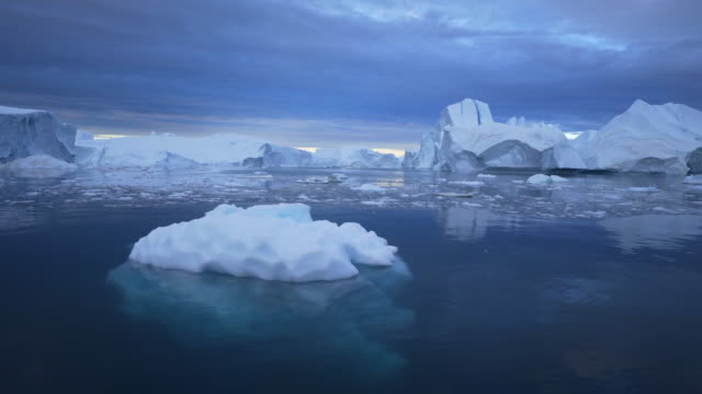 peaceful view of disko bay with icebergs floating in water against sky - inlet stock videos & royalty-free footage