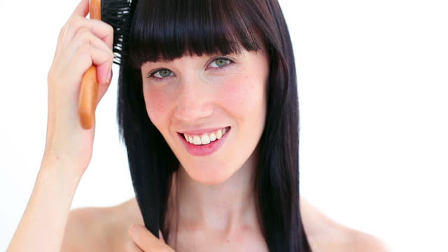stockvideo's en b-roll-footage met peaceful woman brushing her hair - haar borstelen