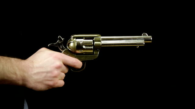 peacemaker gun against black background - handgun stock videos and b-roll footage