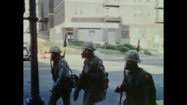 vídeos y material grabado en eventos de stock de peaceway temple front before camera pans to show the burning and smoking buildings in downtown dc after the 1968 riots. the national guard patrol,... - 1968