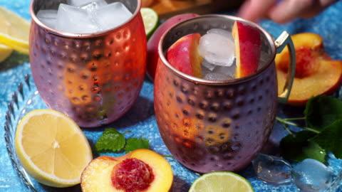 peach moscow mule - mug stock videos & royalty-free footage