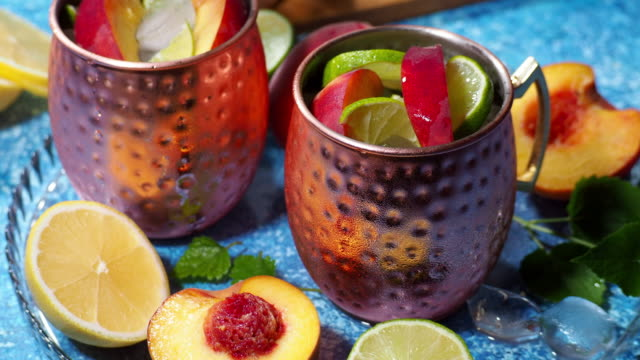 peach moscow mule - mule stock videos & royalty-free footage