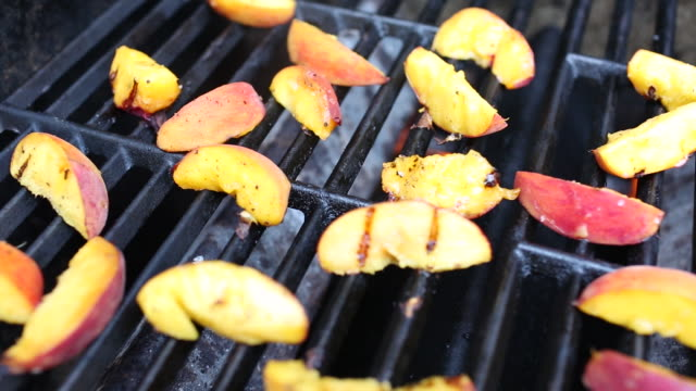 peaches grilling on a barbecue. - peach stock videos & royalty-free footage