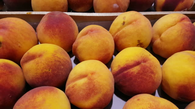 peaches on display in market hall - peach stock videos & royalty-free footage