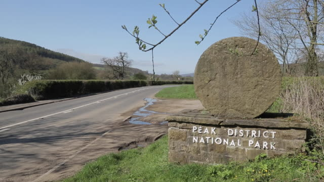 peak district nation park entrance millstone at beeley, chatsworth, derbyshire, england, uk, europe - millstone stock videos & royalty-free footage