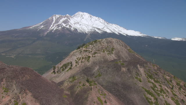 WS AERIAL POV Peak Of Black Butte and Mount Shasta in background, California