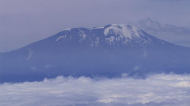 peak of mt kilimanjaro from airplane, tanzania - mt kilimanjaro stock videos & royalty-free footage
