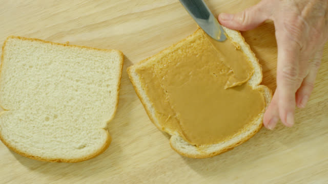 peanut butter and jelly sandwich - preserve stock videos and b-roll footage