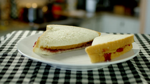 peanut butter and jelly sandwich - table top view stock videos & royalty-free footage
