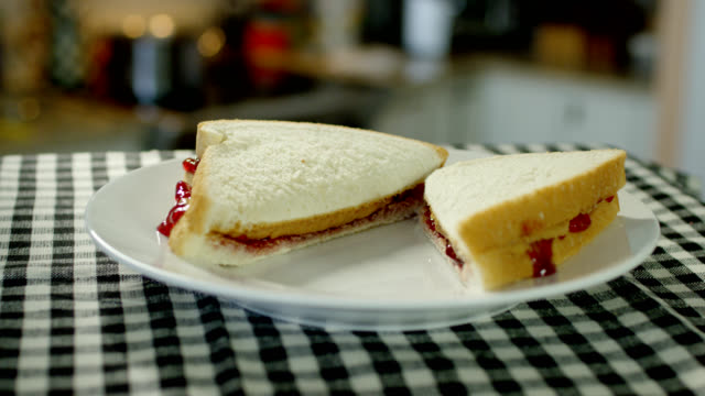 peanut butter and jelly sandwich - jam stock videos & royalty-free footage