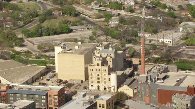 ws aerial pearl brewery building and reveal downtown / san antonio, texas, united states - san antonio texas stock videos and b-roll footage