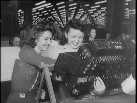 pearl harbor widows build aircraft at lockheedvega plant in burbank california / women working in shop / woman lowers mask / view of work shop with... - vedova video stock e b–roll