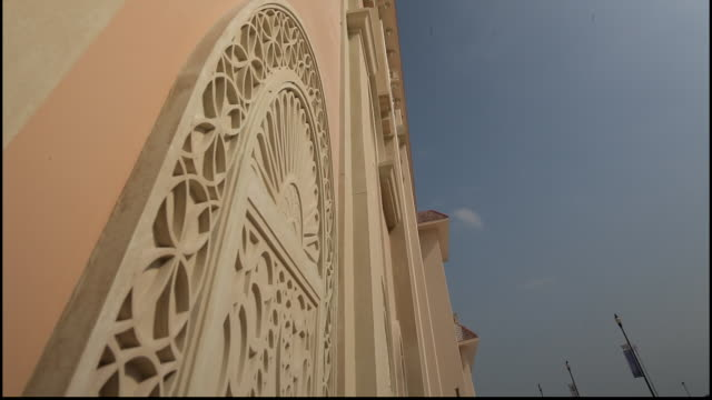 pearl island qatar cu lowangle view of a highly carved arabesque arch on the blindwindow of a neoclassical designed residence on pearlisland - neo classical stock videos & royalty-free footage