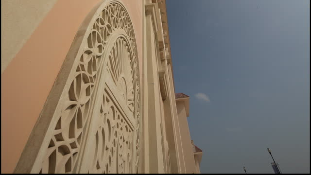 pearl island, qatar. low-angle view of a highly carved arabesque arch on the blind-window of a neo-classical designed residence on pearl-island. - neo classical stock videos & royalty-free footage