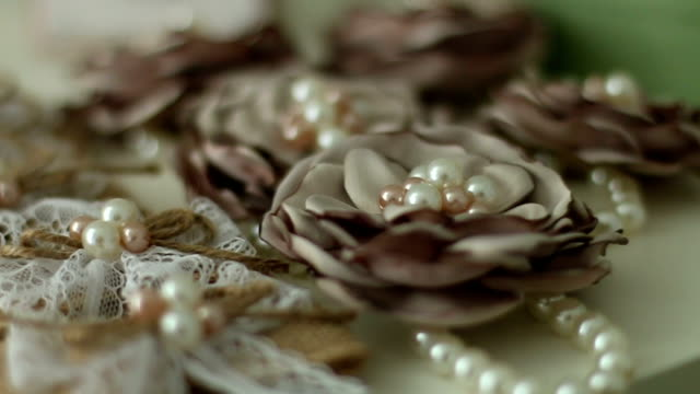 Pearl jewelry and flowers