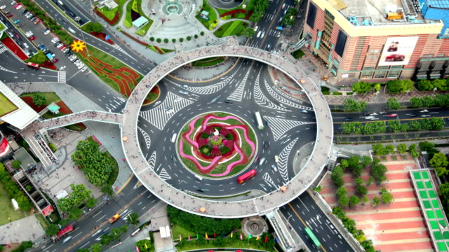 pearl ring roundabout, shanghai, china (2 shots - static & zooming) - roundabout stock videos and b-roll footage