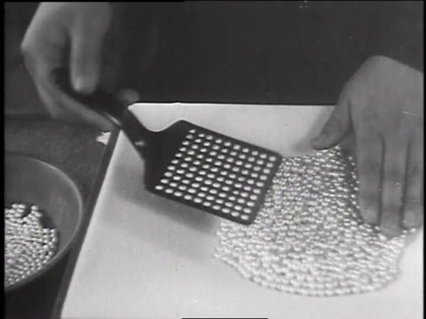 pearls being sorted / woman polishing and sorting pearls