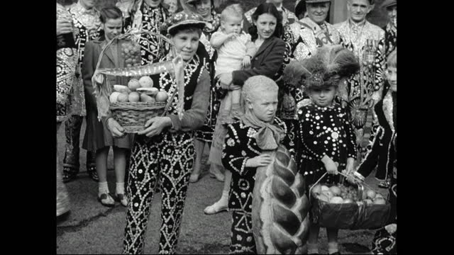 pearly children holding harvest festival offerings; 1949 - english culture stock videos & royalty-free footage
