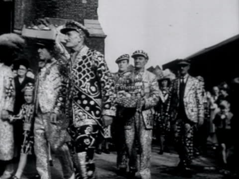 Pearly King and Queens arrive at St Mary's church on the Old Kent Road for their traditional harvest festival