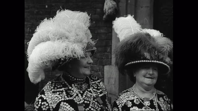 pearly king and queens smile for the camera; 1949 - english culture stock videos & royalty-free footage