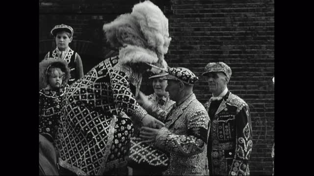 pearly kings and queens arrive at harvest festival by cart; 1949 - english culture stock videos & royalty-free footage
