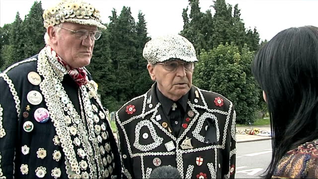 pearly kings and queens attend funeral of larry barnes; roy york and pat jolly interview sot - jolly video stock e b–roll