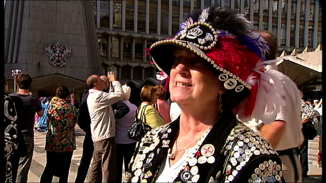 pearly kings and queens celebrate harvest festival; england: london: city of london: ext pearly kings and queens wearing costumes gathering at... - harvest festival stock videos & royalty-free footage