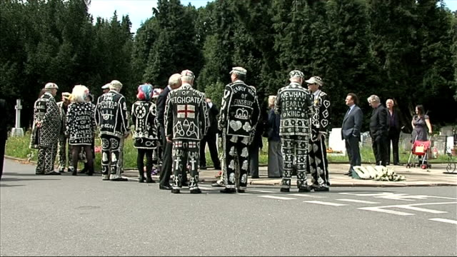 pearly kings and queens pay their respects to larry barnes pearly kings and queens and other mourners gathered for barnes's funeral various shots... - john scott stock videos and b-roll footage