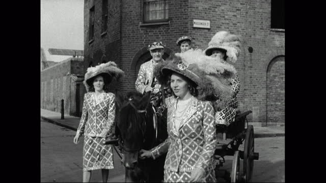 pearly kings and queens travel to harvest festival by cart; 1949 - english culture stock videos & royalty-free footage