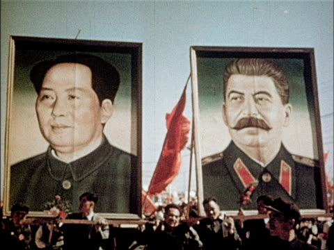 peasants march with signs declaring record harvests / mao waves to crowd / office workers march with portraits of chairman mao and joseph stalin /... - mao tse tung video stock e b–roll