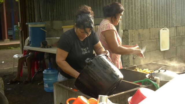 Peasants prepare food in the outdoors in Ticuantepe, Nicaragua.