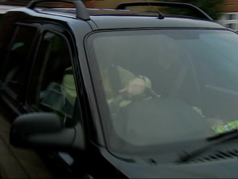 peat inquiry findings itn michael fawcett into car drives away as leaving house int sir michael peat interviewed sot don't know anything aobut his... - michael fawcett stock videos and b-roll footage