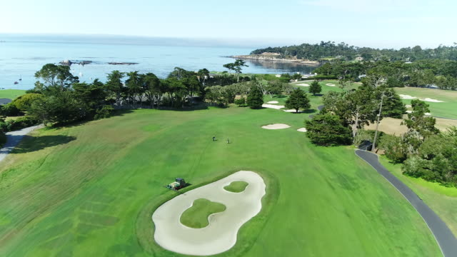 Pebble Beach Shoreline Golf Course - Drone - Flying Close To Hole on Putting Green
