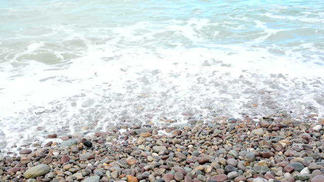Pebble beach with waves.