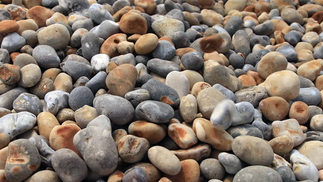 pebbles falling on a beach. slow motion. - super slow motion stock videos & royalty-free footage