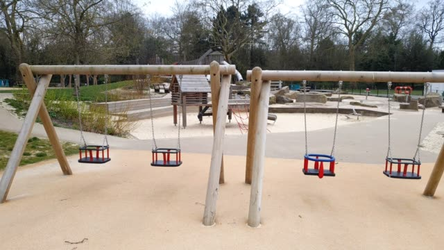 peckham rye play area is closed to the public during the coronavirus pandemic on march 30 2020 in london england - brian dayle coronavirus stock videos & royalty-free footage