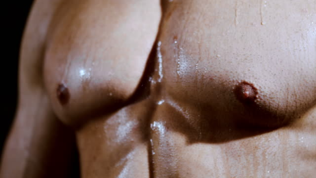 slo mo pectoral muscles covered in sweat - chest torso stock videos & royalty-free footage