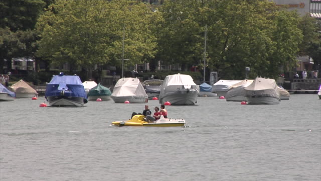 pedal boat in lake zürich - pedal boat stock videos and b-roll footage