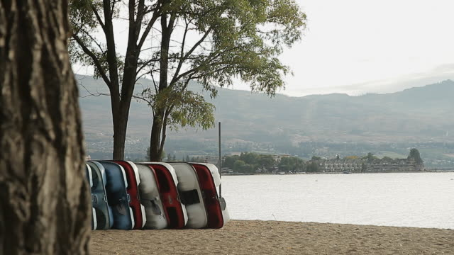 stockvideo's en b-roll-footage met pedalos on each other near the water - waterfiets