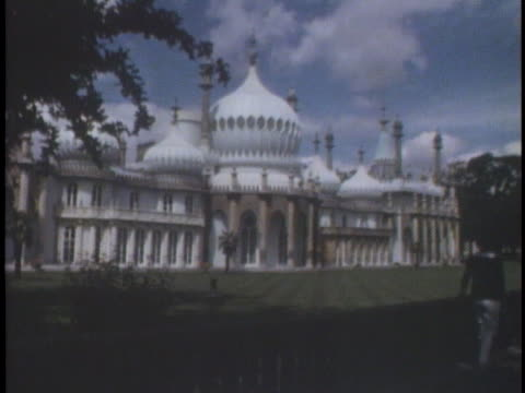 a pedestrian admires the ornate white turrets and domes of the royal pavilion in brighton uk - ornate stock videos & royalty-free footage