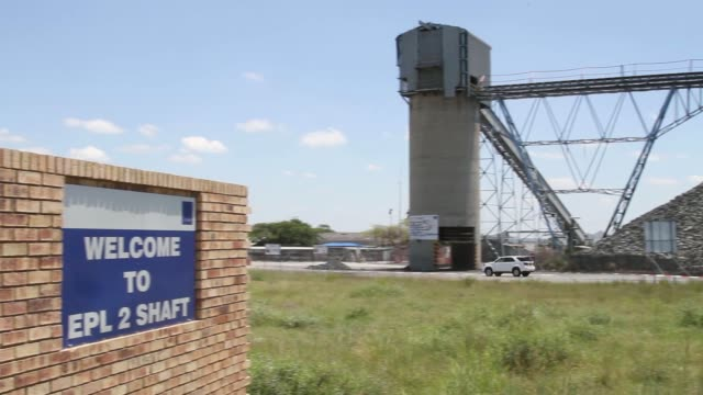 a pedestrian and a vehicle pass by the wonderkop platinum processing plant operated by lonmin plc in marikana south africa on thursday feb 13... - mine shaft stock videos and b-roll footage