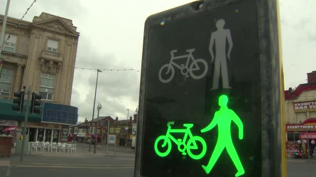 pedestrian and cyclist crossing in blackpool - street light stock videos & royalty-free footage