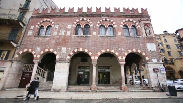 A pedestrian and van passes a branch of Banca Popolare di Verona bank a subsidiary of Banco Popolare SC in Verona Pedestrians pass a branch of Banca...