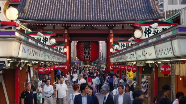 pedestrian at sensoji templehozomon or treasure house gate on may 30 2017 in tokyo japan - shitamachi stock videos and b-roll footage