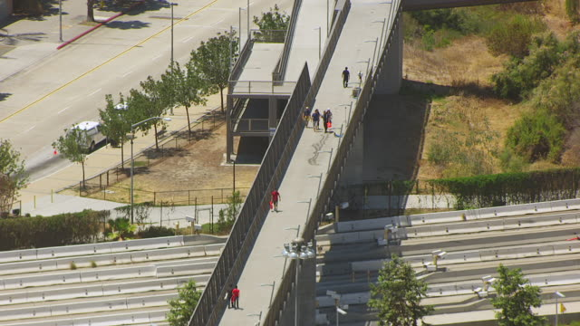 WS ZO AERIAL POV Pedestrian bridge over roadway at international border crossing between Tijuana Mexico and San Diego / San Diego, California, United States