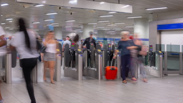 pedestrian commuter crowd at subway station ticket hall in london england uk - railway station stock videos & royalty-free footage
