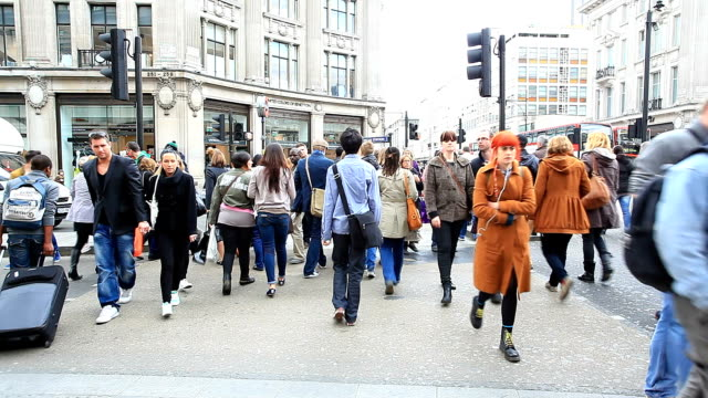 pedestrian commuter crowd walking at oxford circus london england - high up stock videos & royalty-free footage