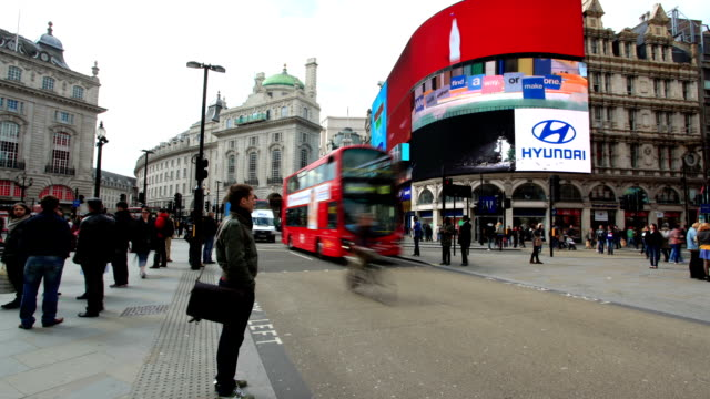 pedestrian commuter crowd walking at piccadilly circus time-lapse london england - piccadilly circus stock videos and b-roll footage